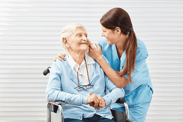 Elderly woman in the wheel chair with the caregiver, Aurora